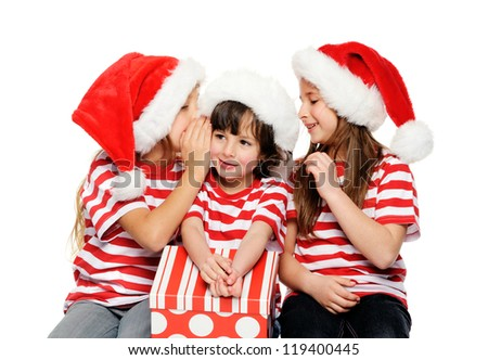 Christmas children having fun with xmas hats, gift box and matching t-shirts isolated on white background - stock photo