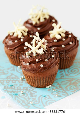 Christmas chocolate cupcake decorated with snowflakes - stock photo