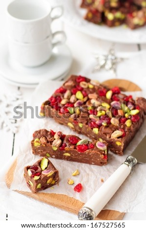 Christmas Chocolate Fudge with Glace Cherries, Pistachios and Coconut, copy space for your text, selective focus, shallow depth of field - stock photo
