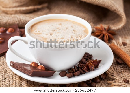 Christmas chocolate with hazelnut cinnamon and star anise on the wooden table - stock photo