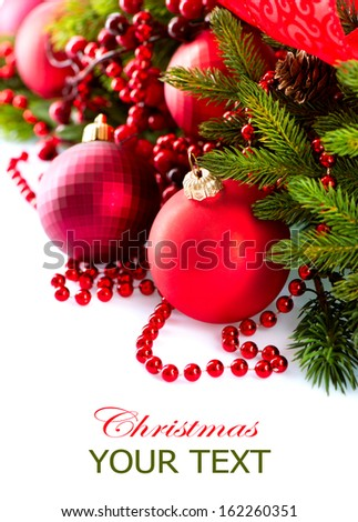 Christmas. Christmas and New Year Baubles and Decorations isolated on White Background.Holiday Border Design Composition. Red Color  - stock photo
