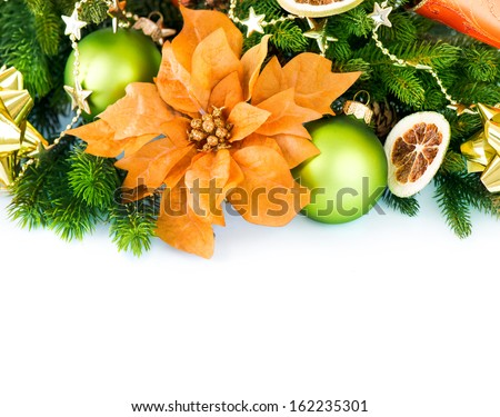 Christmas. Christmas and New Year Decorations with Baubles and Ribbon isolated on white background. Orange and Green color. Border art Holiday Design  - stock photo
