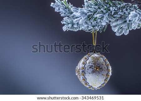 Christmas. Christmas ball. Luxury christmas ball on christmas tree. Home made Christmas ball hanging on pine twig. Space stars background. - stock photo