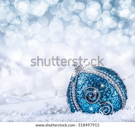 Christmas.Christmas blue balls and silver ribbon snow and space abstract background. - stock photo