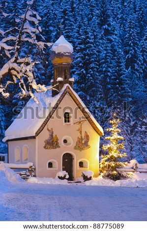 christmas church with tree at evening - stock photo
