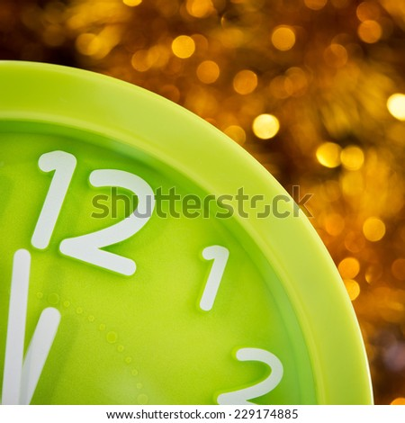 Christmas clock at twelve. New years background - stock photo