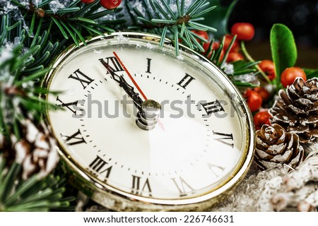 Christmas clock with winter decoration - stock photo