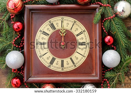Christmas clock with winter decoration - 12 o' clock - midnight  - stock photo