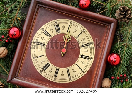 Christmas clock with winter decoration - 12 o' clock - midnight - stock photo