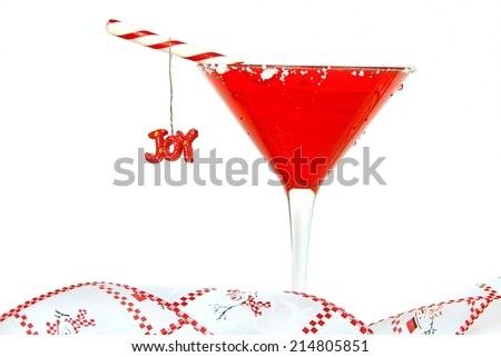 Christmas cocktail with holiday ornament and ribbon isolated on white background - stock photo