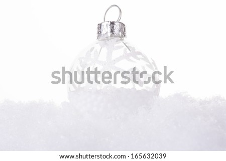 christmas cold background, with snow and christmas balls (selective focus) - stock photo
