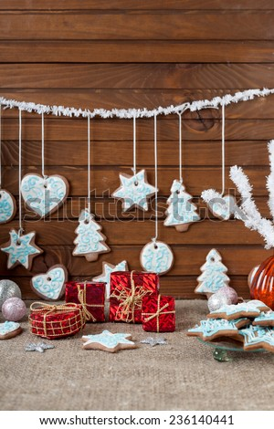 Christmas colorful gingerbread and Christmas decoration on a linen background