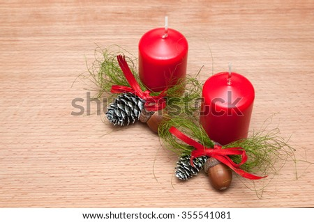 Christmas composition  candle, cones, acorns. on wooden background. space for inscriptions. - stock photo