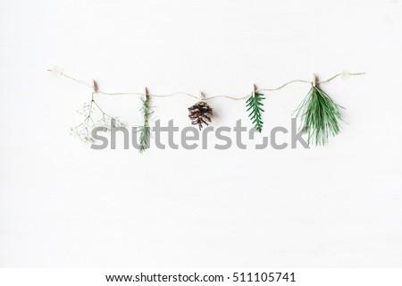 Christmas composition. Conifers branches, gypsophila flowers, pine cone. Christmas concept. Flat lay, top view