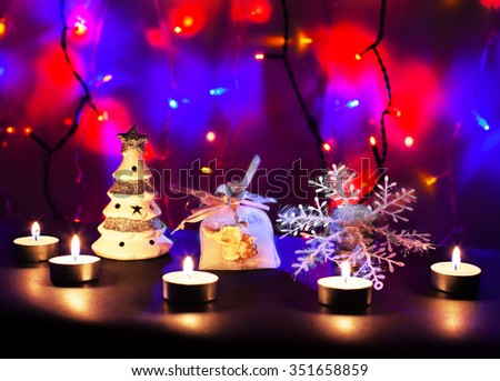 Christmas composition for the Christmas tree and candles. - stock photo