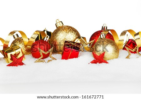 Christmas composition is with colorful balls on snow - stock photo