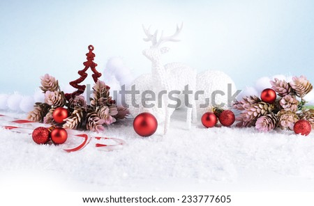 Christmas composition on snow close-up - stock photo