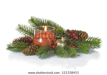 Christmas composition with a burning candle - stock photo
