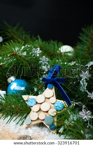 Christmas composition with blue wooden star and decoration. Christmas greeting card.