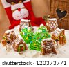 Christmas composition with cakes, snowman and deer - stock photo