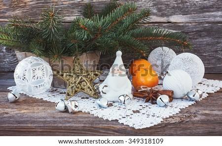 Christmas composition with Christmas tree, gnome, Christmas balls. Toned - stock photo