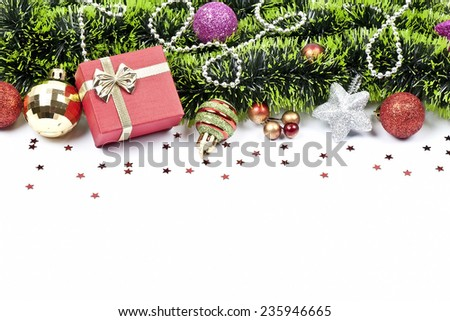 christmas composition with colored balls, red stars, green tinsel. festive arrangement with place for your text  - stock photo
