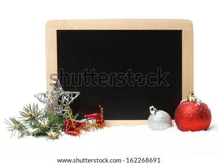 Christmas composition with decorations and board for chalk  - stock photo