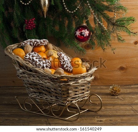 Christmas composition with evergreen and fresh clementines . - stock photo