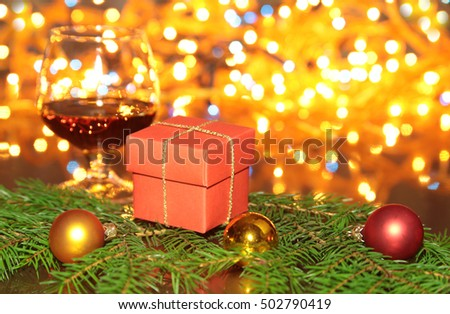 Christmas Composition with Gift box and light, red balls on wooden table.