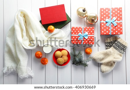 Christmas composition with gift boxes, cookies and decorations on a white table - stock photo