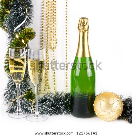 Christmas composition with golden ball and champagne