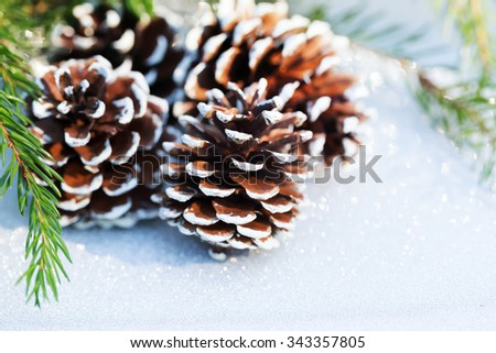 Christmas composition with pine cone - stock photo