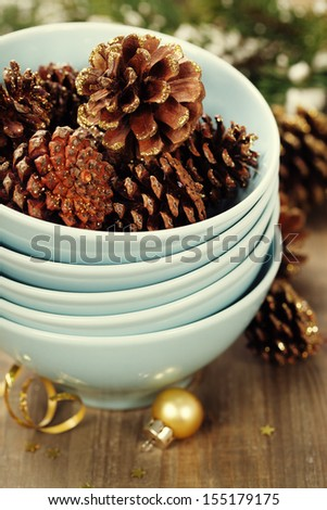 Christmas composition with pine cones and decorations - stock photo