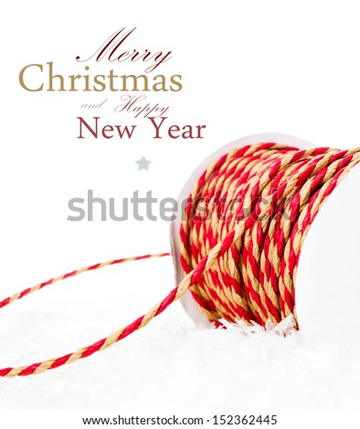 Christmas composition with red ribbon and snow isolated on white background  (with easy removable sample text) - stock photo