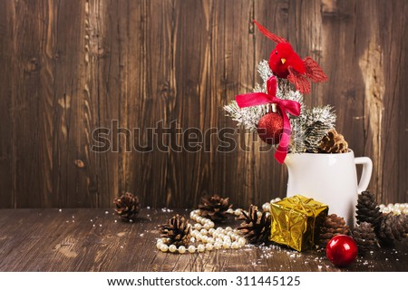 Christmas composition with small red bird and fir tree decorations. Xmas greeting card. Selective focus, vintage style - stock photo