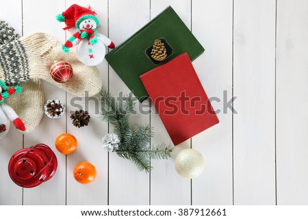 Christmas composition with snowmen and decorations on a white table