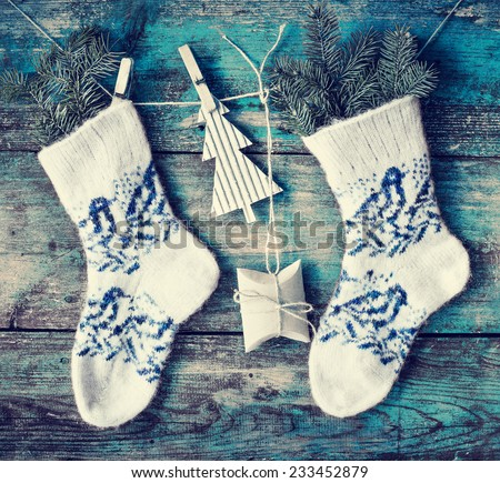 christmas composition with socks, present boxes fir and fir-cone on wooden background/ Christmas card with christmas rustic decorations - stock photo