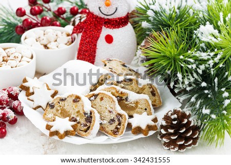 Christmas composition with Stollen and cookies on white table, closeup