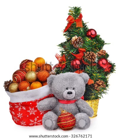 Christmas composition with teddy bear tree and santa bag isolated over white - stock photo