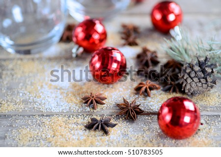 Christmas composition with toys and anise on a wooden rustic background