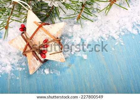 Christmas composition with white wooden star on blue background