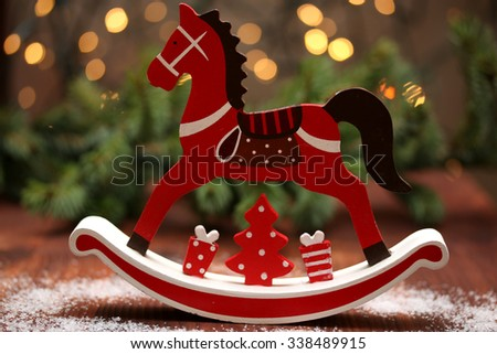 Christmas composition with wooden rocking horse.Winter.Abstract light background.Selective focus. - stock photo