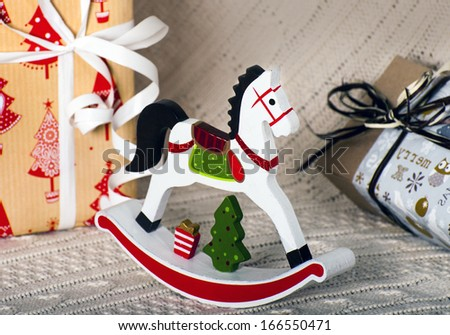 Christmas composition with wooden toy rocking horse