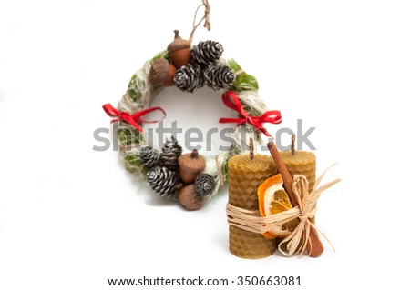 Christmas composition - wreath, wax candles, cinnamon and dried orange. isolated on white background. space for inscriptions. - stock photo
