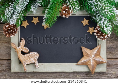 Christmas concept. Black board for text and wooden ornaments, horizontal - stock photo