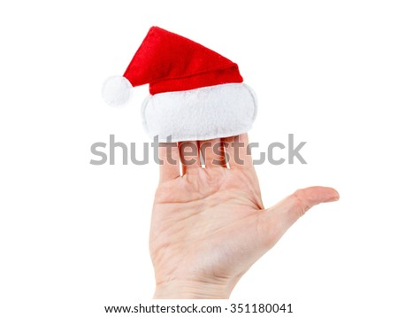 Christmas concept. Cute female hand holding a santa hat. Isolated on white background - stock photo