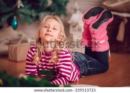 Christmas concept.  Girl near christmas tree. - stock photo