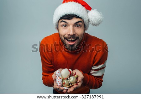 Christmas concert. Bearded man holding a gift) - stock photo