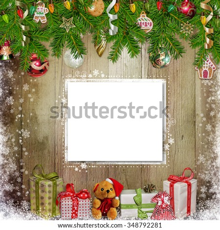 Christmas congratulation background with card, gifts, pine branches and Christmas ornaments on the wooden background - stock photo
