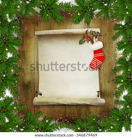 Christmas congratulatory background with pine branches, a roll of paper for text and Christmas socks on a wooden background